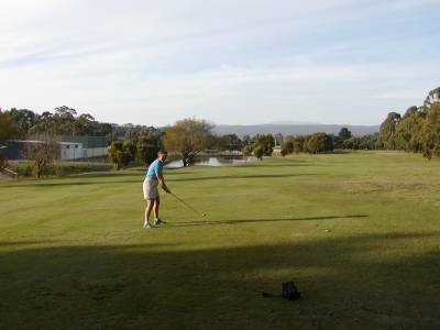 Kathy hits from the middle of the fairway at the Launceston Golf Club